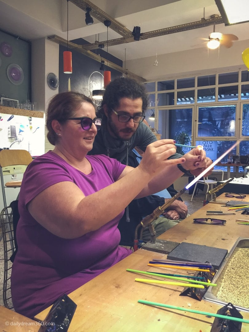 Sharon Mendelaoui making glass bead at 1200 Derece Glass Studio and Cafe Balat Istanbul