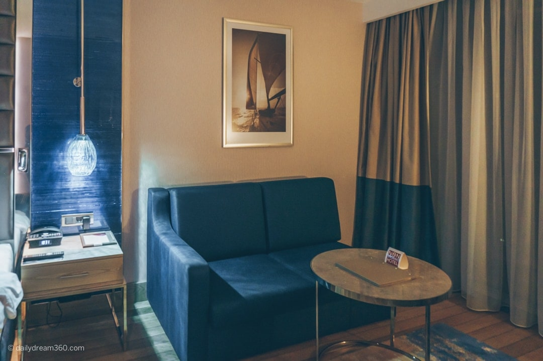 Couch and sitting area inside room at Crowne Plaza Florya