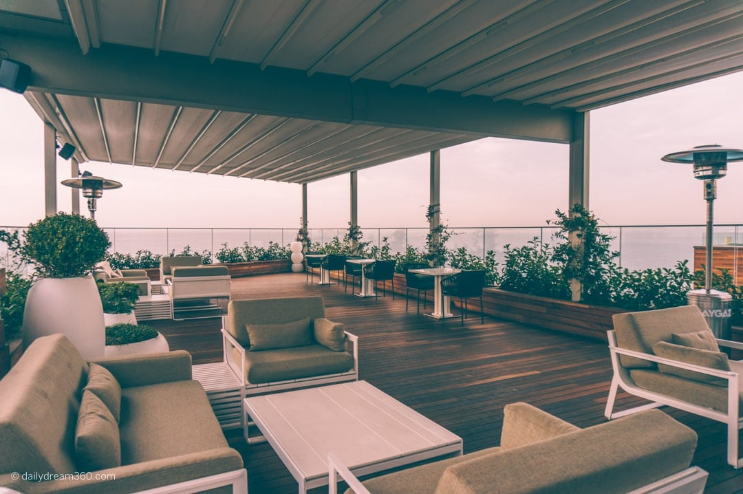 Outdoor covered sitting area at rooftop bar at Crowne Plaza Florya