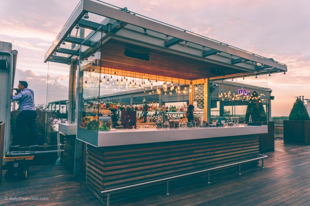 Bar area and two covered rooftop lounge areas