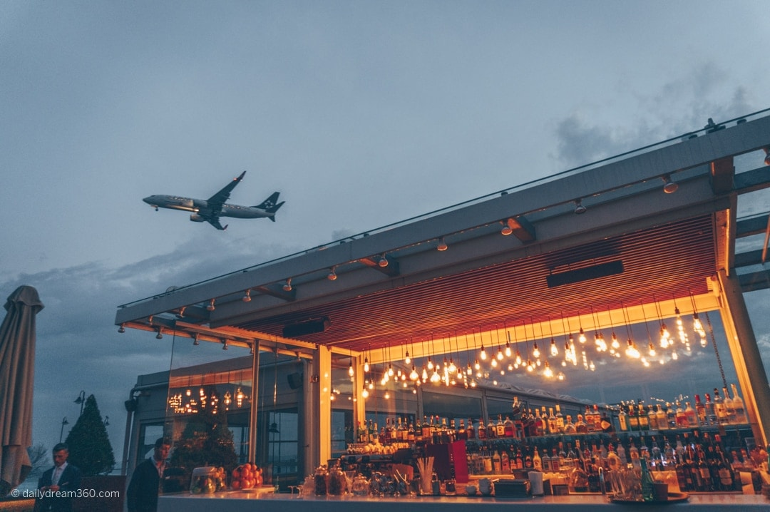 Airplane flying over rooftop bar Crowne Plaza Istanbul Florya