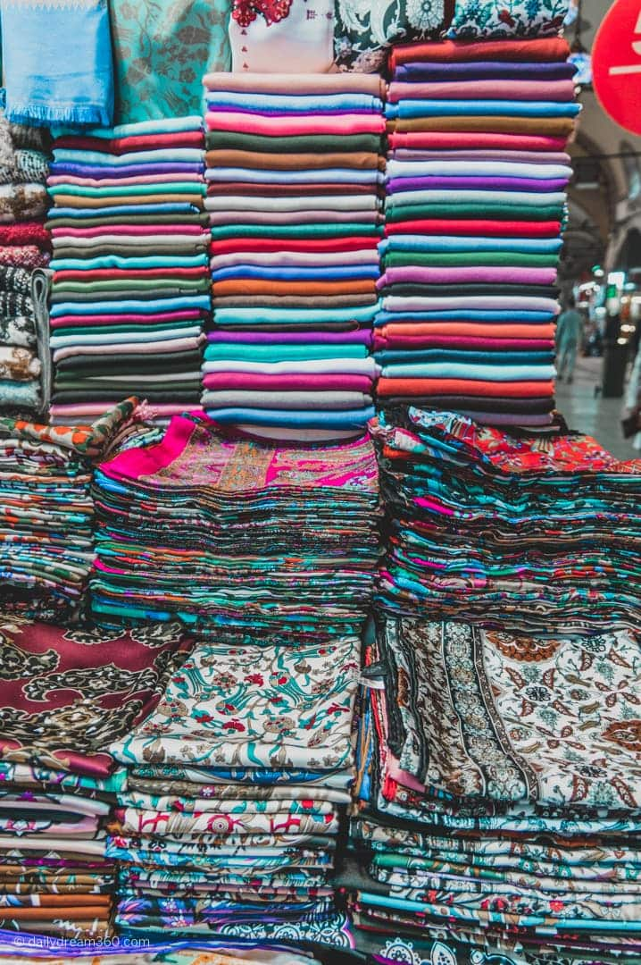 hand crafted scarves piled up in booth at Grand Bazaar
