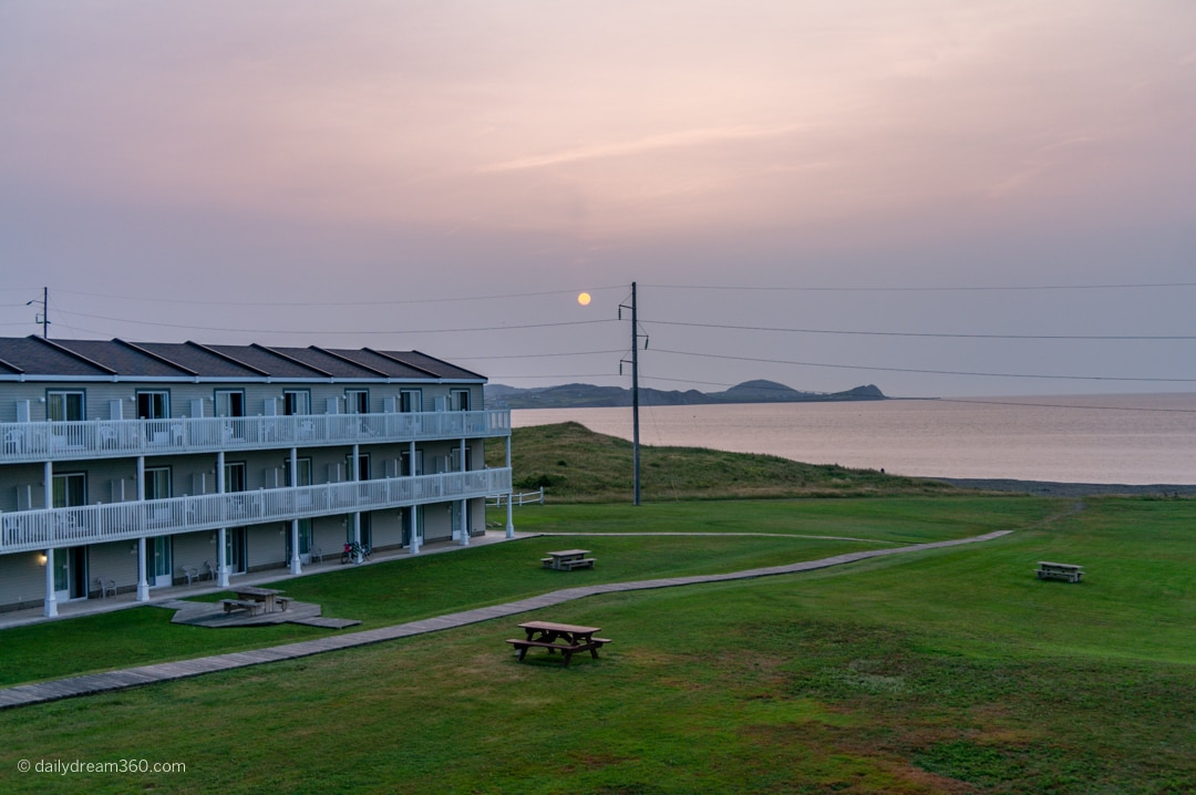 View from hotel room as sun rises Chateau Madelinot Hotel Cap Aux Meules Island Iles de la Madelaine