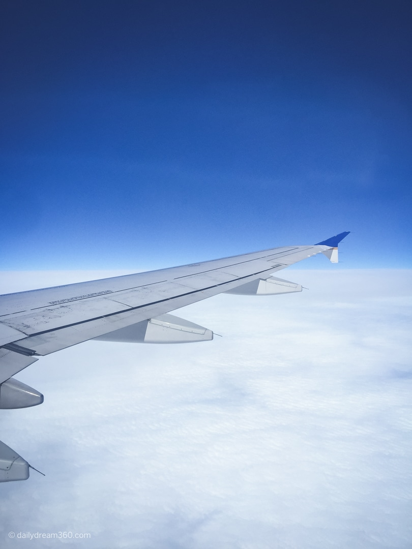 Plane wing in sky from United Airlines flight to Lafayette Louisiana