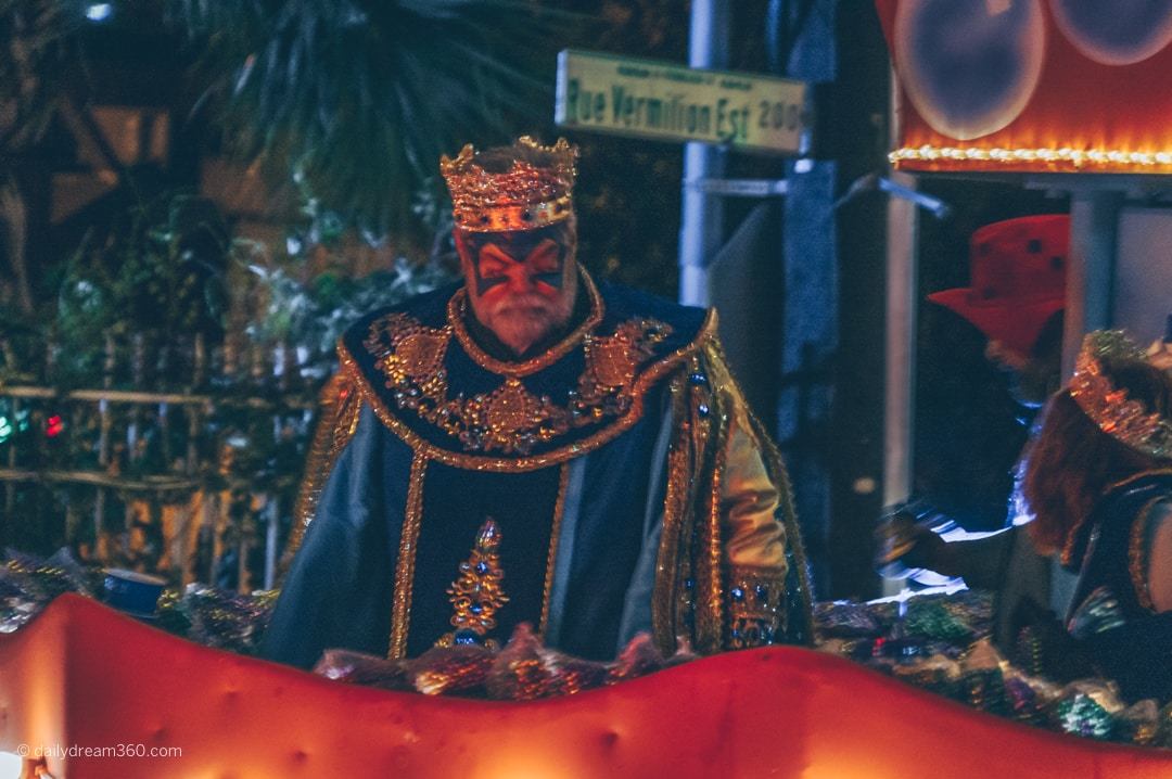 Man dressed as king looks out from float in Lafayette Louisiana Mardi Gras Parade