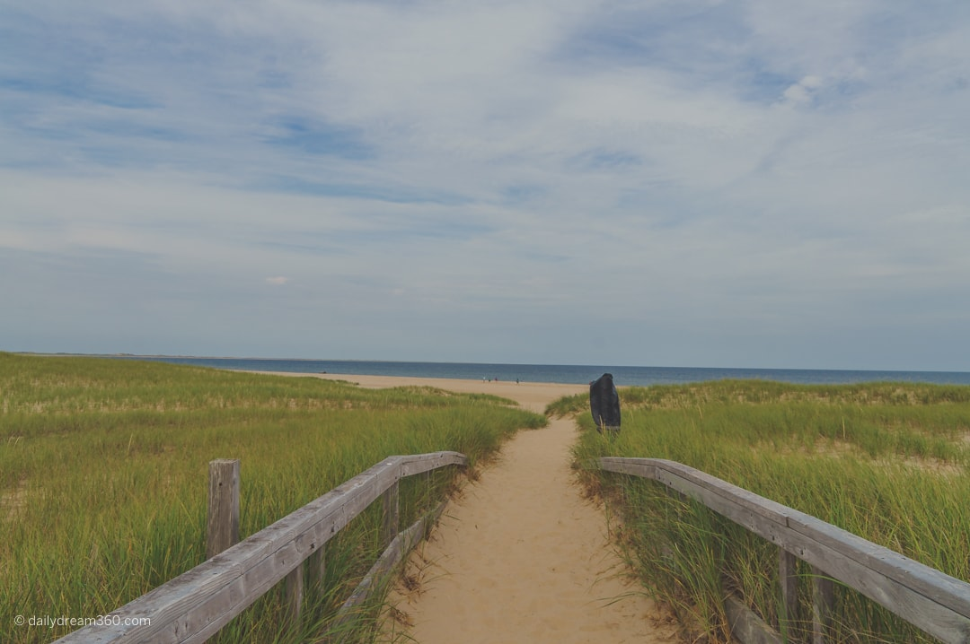 Pathway through grass and sand to Old Harry Beach Grand Entree Iles de la Madelaine Quebec