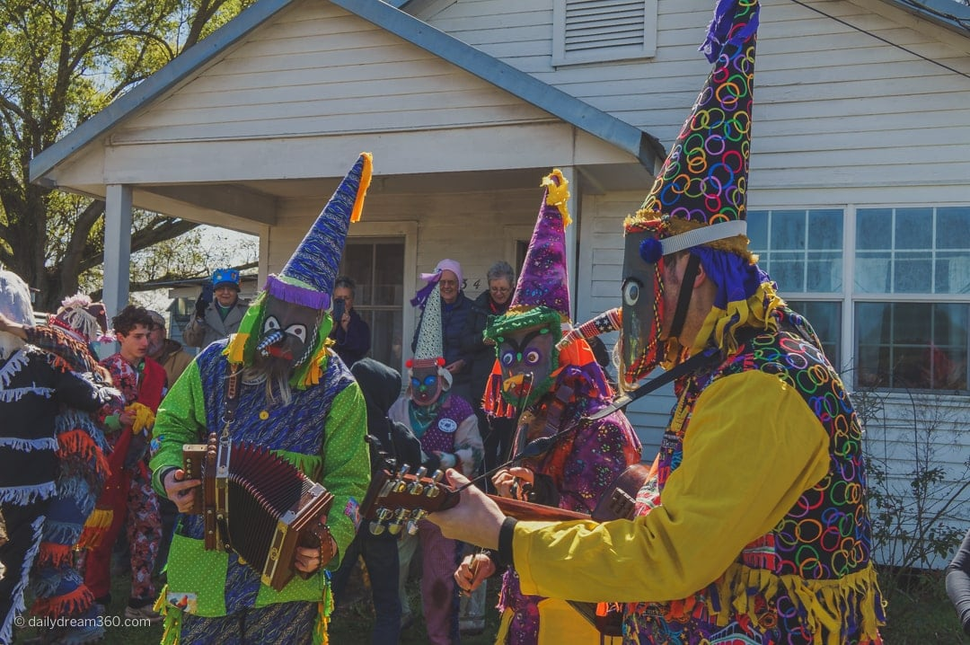 Riders play music at stop during Getting my shoes tied together as part of Ossun Louisianna - Courir de Mardi Gras
