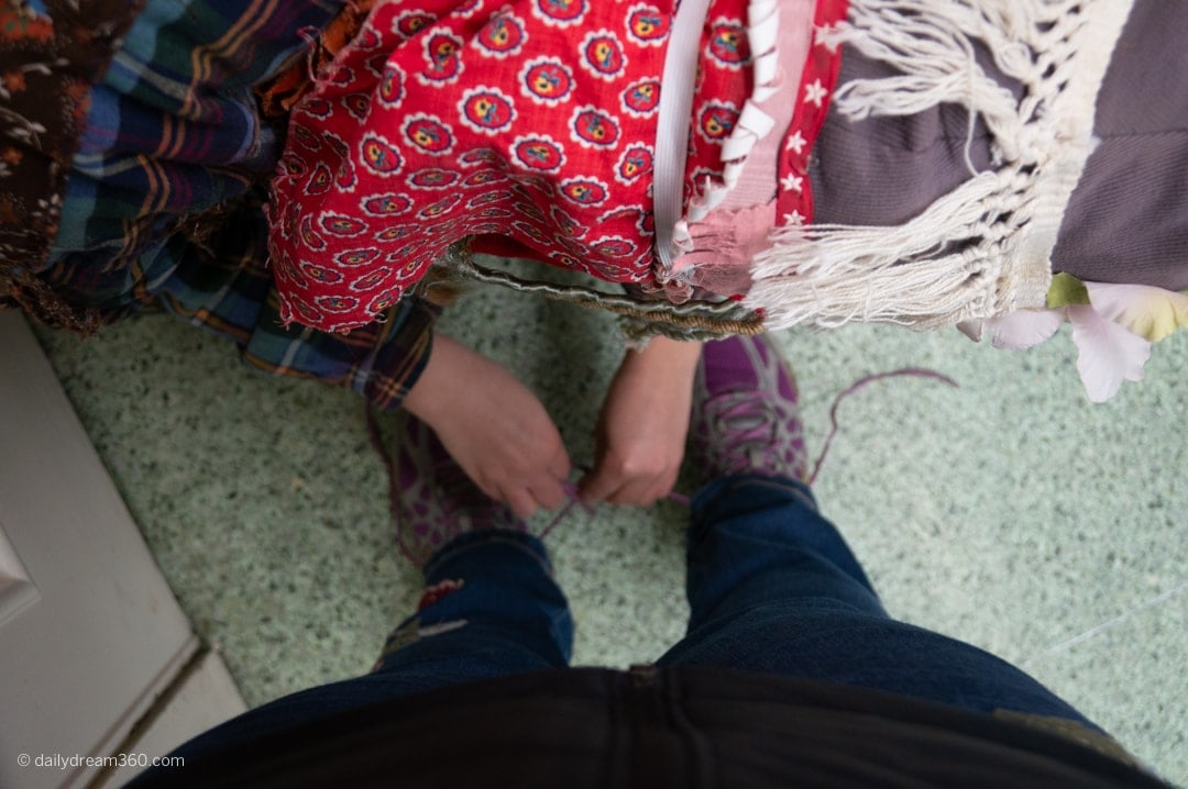 Getting my shoes tied together as part of Ossun Louisianna - Courir de Mardi Gras