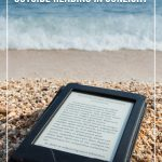Ebook reader lying on beach with text Best eReaders for the Beach and the Outdoors