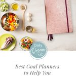 Planner next to healthy food on table