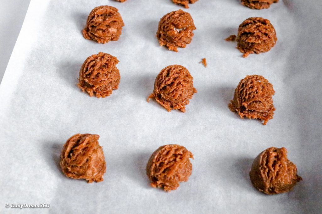 Keto Almond Butter Cookies with Chocolate Recipe  mixing bowl with ingredients dough balls on baking sheet