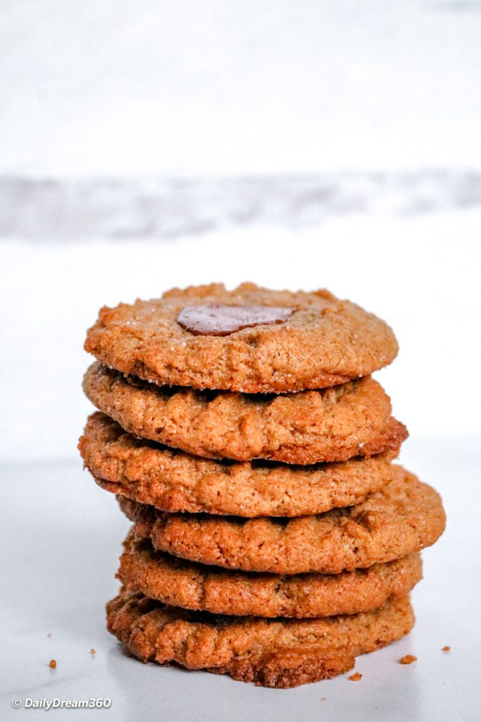 Stacked Keto Almond Butter Cookies with Chocolate on countertop