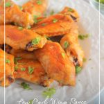 Keto wings on white plate with sauce and napkin and text: Low Carb Wing Sauce Keto Chicken Wings Recipe