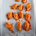Keto wings on pan with sauce and text: Low Carb Wing Sauce Keto Chicken Wings Recipe