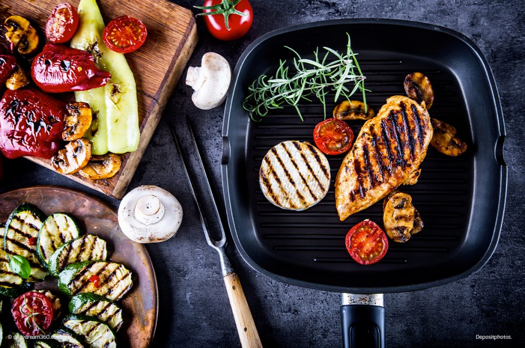 Grilled food on counter in grill pan