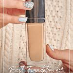 Woman holding foundation bottle with text: Best Foundation for Aging Skin Over 50