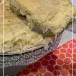 Cabbage frittata in stand and on plate with pin text Can You Mix Cabbage and Eggs? Try this Cabbage Frittata Recipe