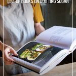 Woman holding cookbook with text How to Detox Sugar with the Best Books on Quitting Sugar (pin image)
