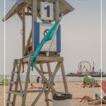 Lifeguard tower with text: Destinations for Summer Road Trips in Ontario