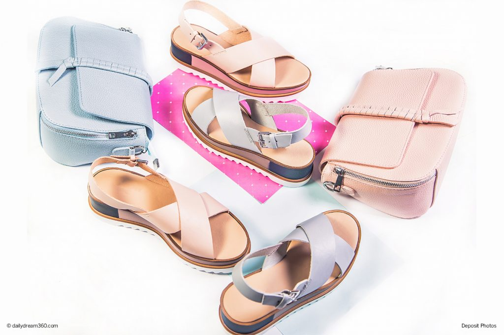 Pastel summer sandals with purses on white background