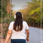 Woman walking on road with pin text Tips on How to Start a Healthy Lifestyle and Stick to It