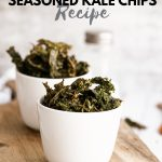 Kale chips in small bowls on wooden board with text Keto-Friendly Seasoned Kale Chips Recipe (Oven Baked or Air Fryer)