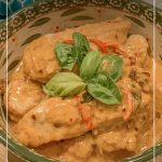 Creamy basil chicken in bowl with basil leaves and text Easy One-Pan Creamy Basil Chicken with Parmesan Recipe (pin image)