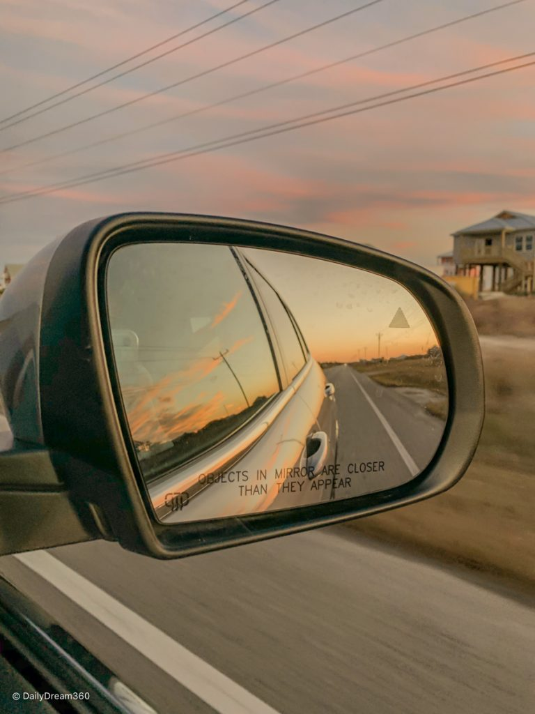 View of sunset in side mirror in Gulf Shores and Orange Beach