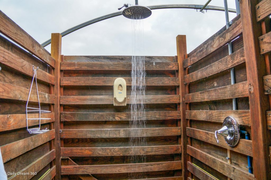 Outdoor shower stall of Wilderness Tent at Long Point Eco Adventures