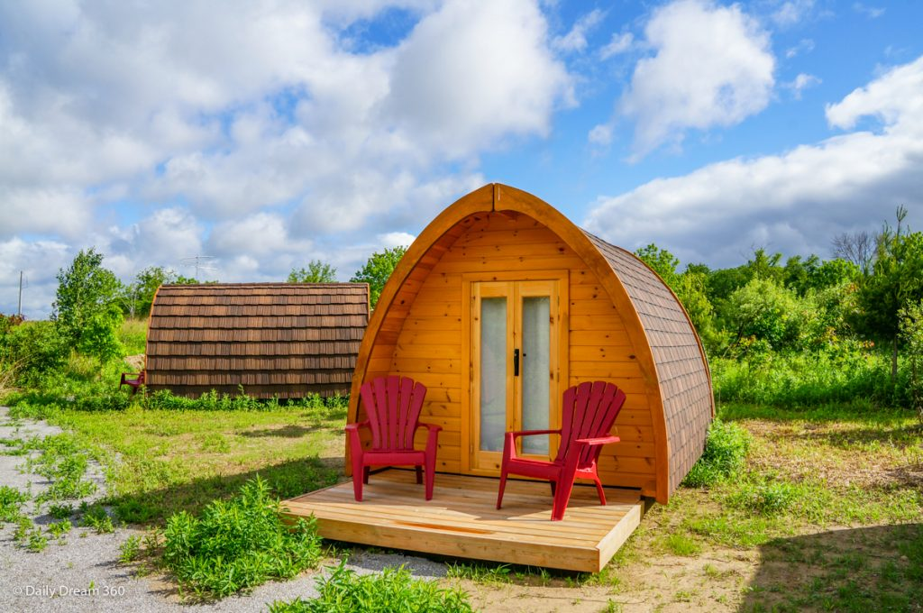 Wilderness Pod with two red chairs on deck at Long-Point-Eco-Adventures