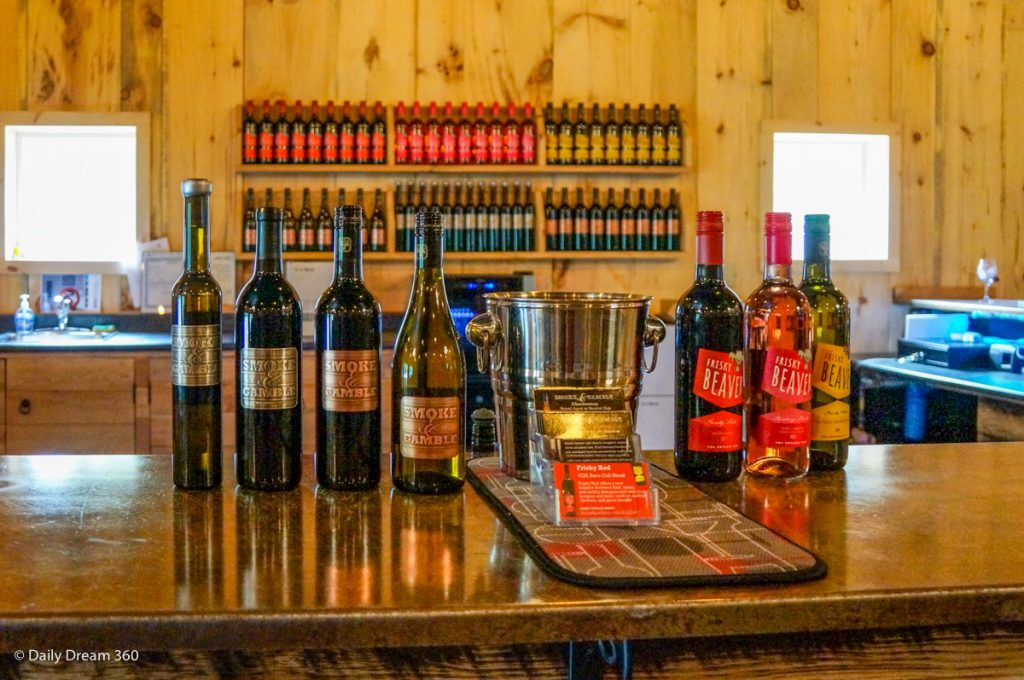 Counter with wines on display at Smoke and Gamble Frisky Beaver Simcoe Ontario