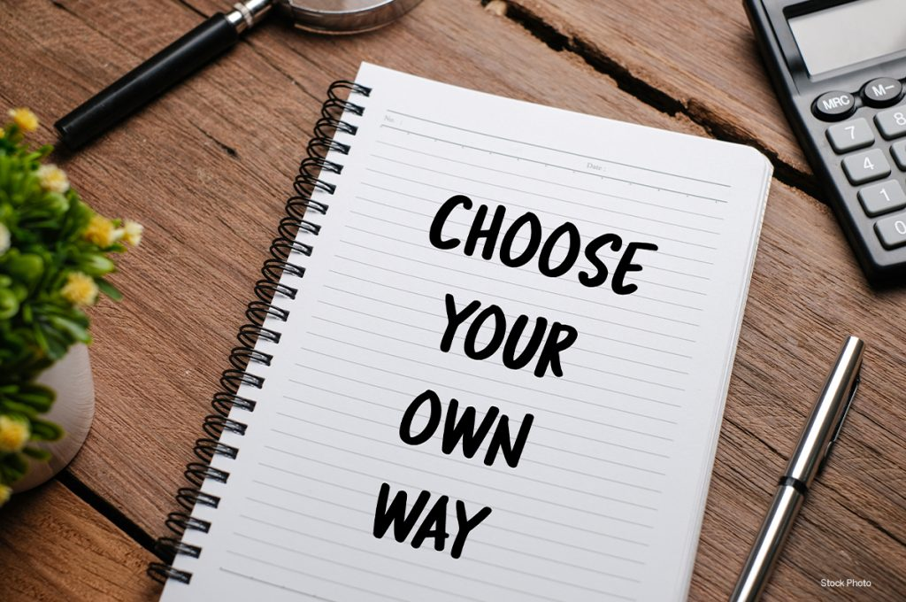 Notebook on desktop with words choose your own way