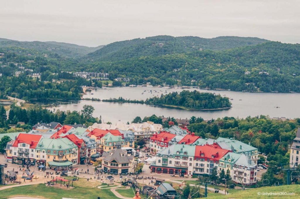 View of Tremblant Village from mountain with lakes and mountains behind