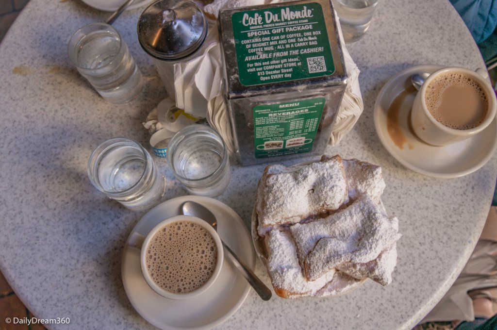 Beignets on table at Cafe du Monde New Orleans