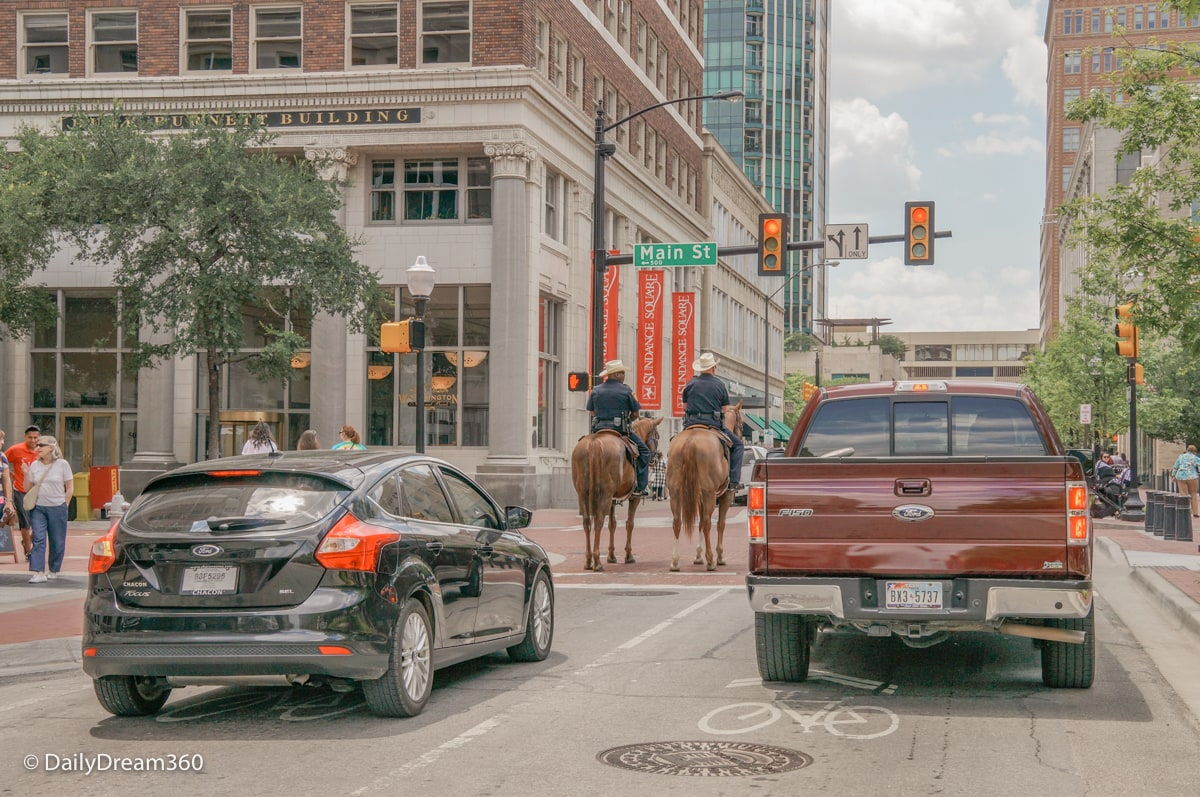 Police on horseback stop at red light in Fort Worth Texas