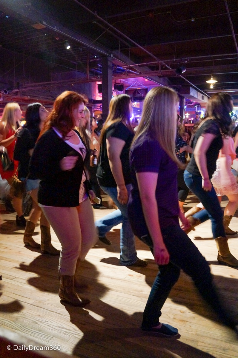 Trying line dancing at Billy Bob's