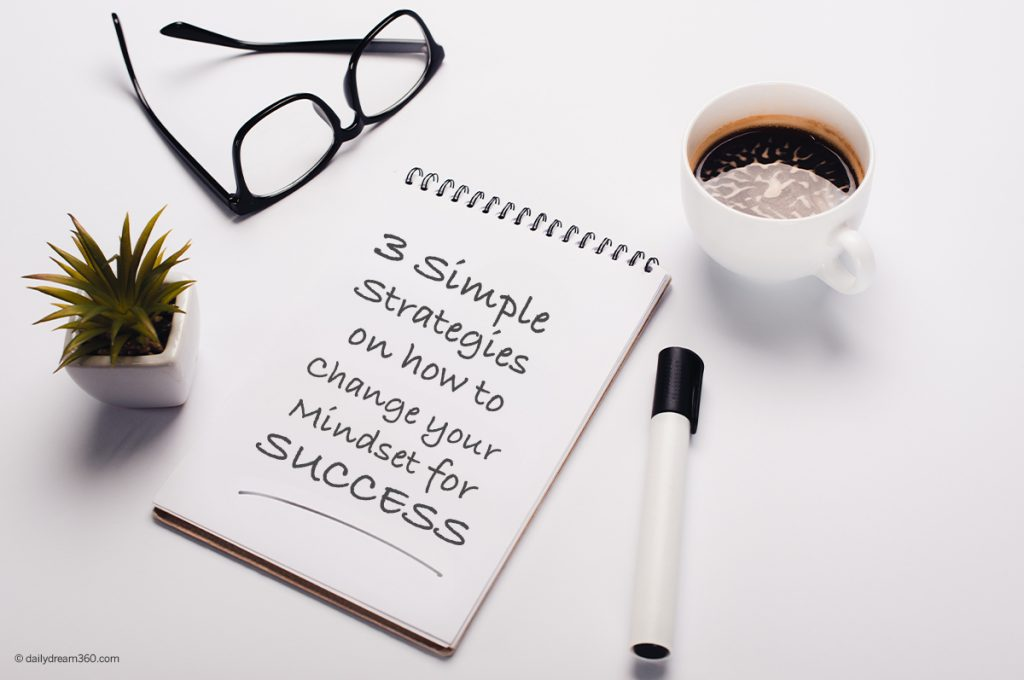 desk with notepad and text: 3 Simple Strategies on How to Change Your Mindset for Success