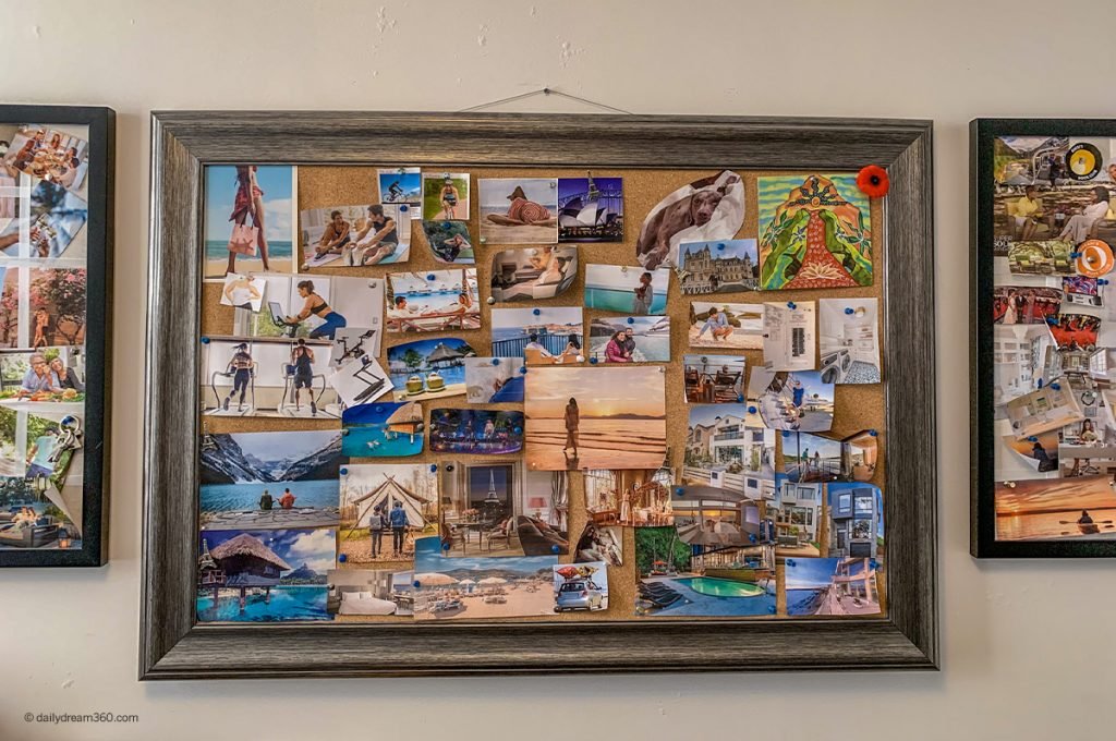 wall with framed vision boards and pictures