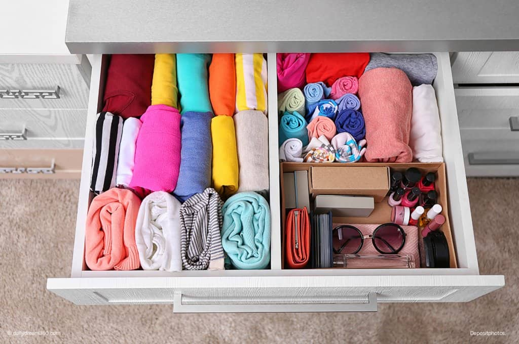 organized bedroom drawer girl folding clothing 7-Day Declutter Challenge: Day 3 How to Declutter Bedrooms