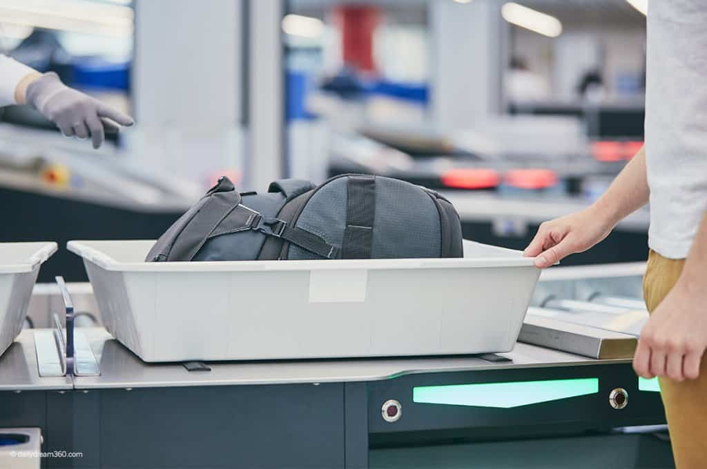 Airport Security bin with bag inside