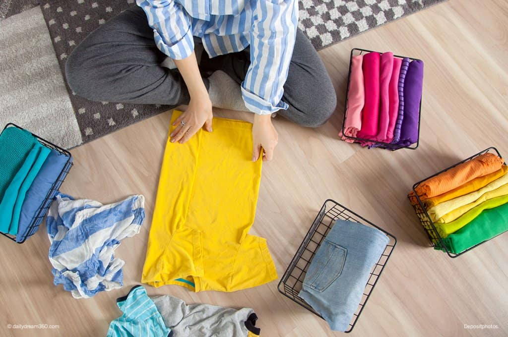 girl folding clothing 7-Day Declutter Challenge: Day 3 How to Declutter Bedrooms