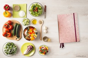 Clever Fox Food journal on table with meal prepped ingredients