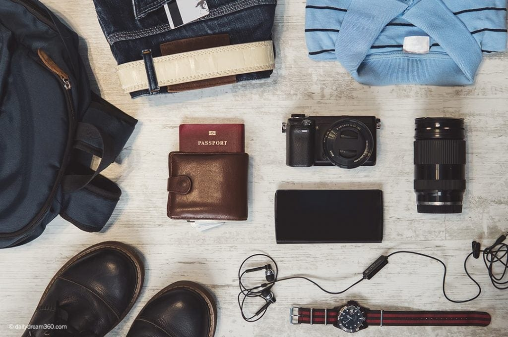 Mens photography gear laid out on floor