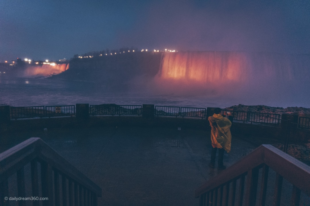 tourist taking photo on platform at Journey behind the falls attraction Niagara Falls