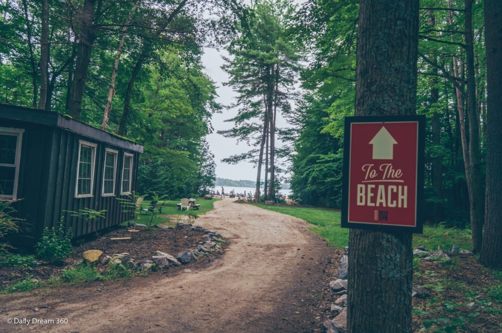 Sign pointing to beach area at Muskoka Beer Spa