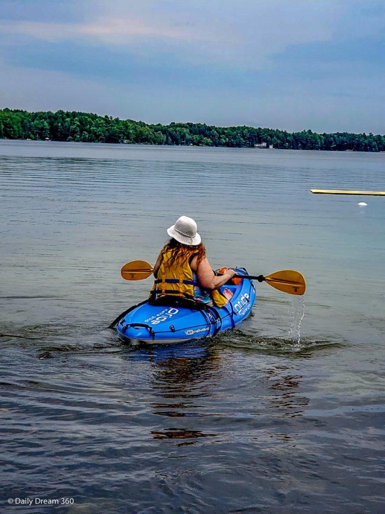 Woman kayaking at Muskoka Beer spa
