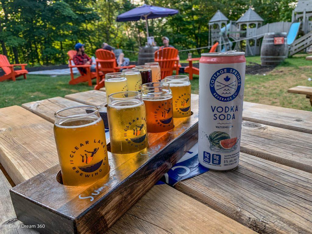 Beer flight and Vodka cooler on table in beer garden at Muskoka Beer Spa