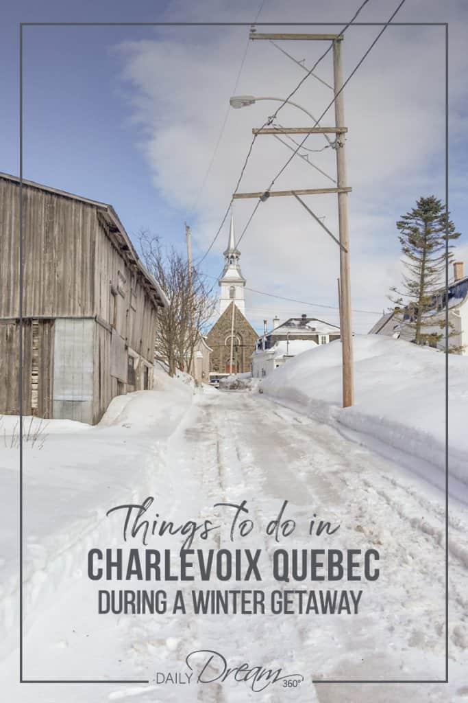 Church and wood buildings on a snowy road in Charlevoix Quebec