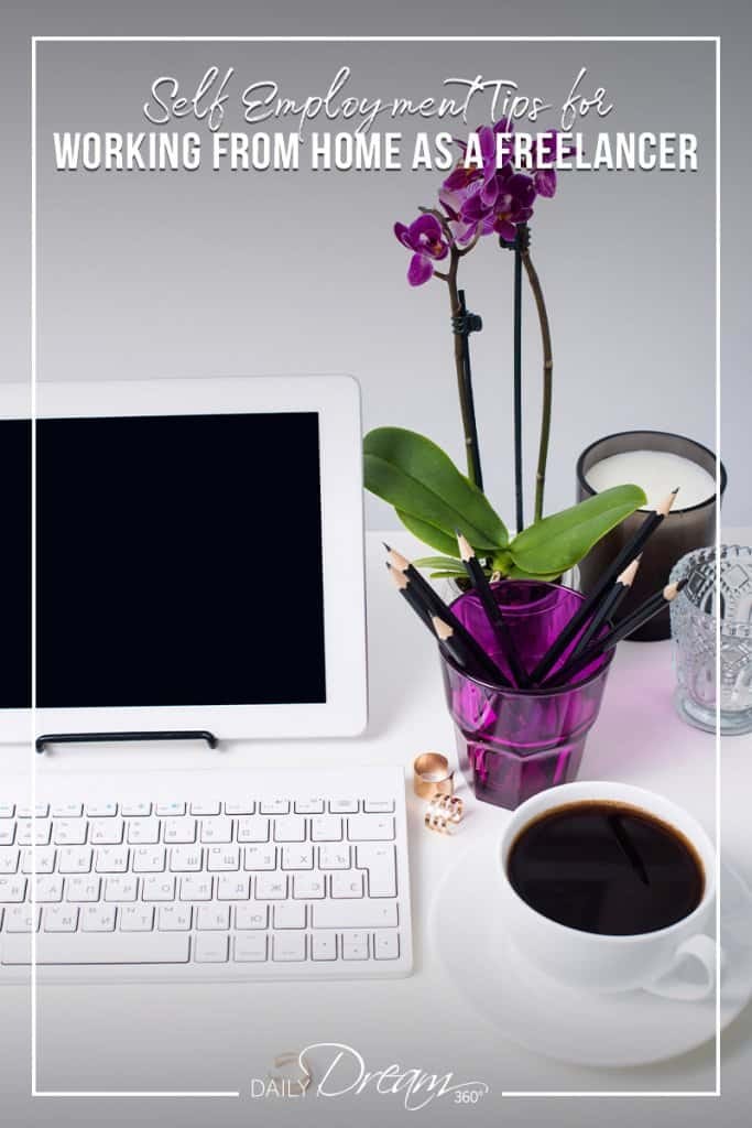 Computer on desk with keyboard and purple flower with text Tips for Working from Home as a Freelancer