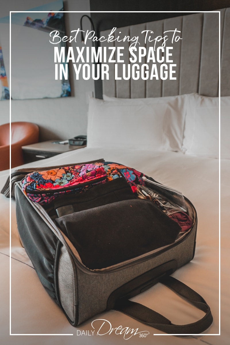 Small luggage open on hotel bed